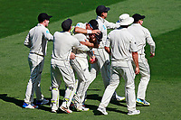 Players celebrate a catch by Kane Williamson to dismiss Stuart Broad, New Zealand Black Caps v England. Day 1 of the day-night, pink ball cricket test match at Eden Park in Auckland. 22 March 2018. Copyright Image: William Booth / www.photosport.nz