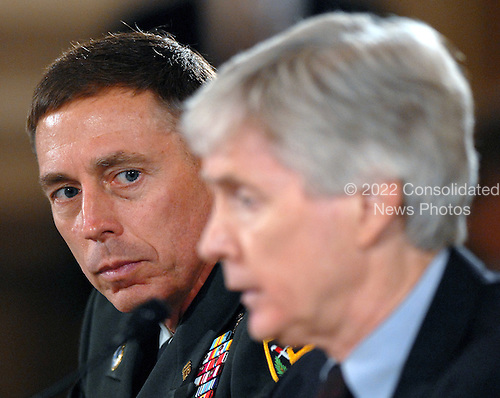 Washington, D.C. - September 10, 2007 -- United States Army General David H. Petraeus, Commander of the Multi-National Force - Iraq (MNF-I), left, and Ryan Crocker, United States Ambassador to Iraq, right, testify on the future course of the war in Iraq while appearing before a joint hearing of the United States House Armed Services Committee and United States House Foreign Relations Committee, Monday, September 10, 2007, on Capitol Hill in Washington..Credit: Ron Sachs / CNP