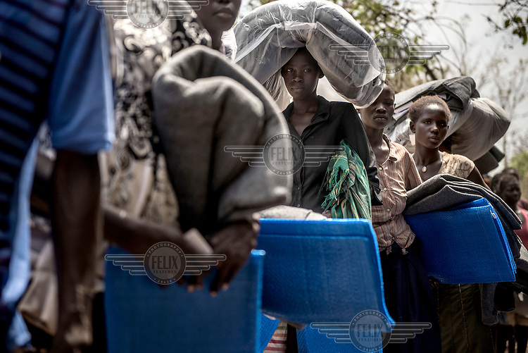 Recently arrived refugees from South Sudan wait to collect blankets and other items from Red Cross volunteers at Imvepi reception centre in northern Uganda.