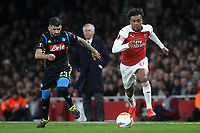 Arsenal's Alex Iwobi races upfield as Elseid Hysaj of Napoli looks on during Arsenal vs Napoli, UEFA Europa League Football at the Emirates Stadium on 11th April 2019