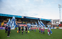 Referee Robert Jones and his officials lead the teams out before the Sky Bet League 2 match between Wycombe Wanderers and Yeovil Town at Adams Park, High Wycombe, England on 14 January 2017. Photo by Andy Rowland / PRiME Media Images.