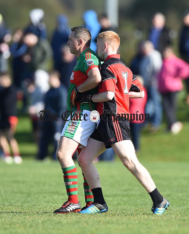 Brendan Moloney of Kilmurry Ibrickane  and Adam Sherlock of Meelick have a close encounter during their Junior A  county final at Gurteen. Photograph by John Kelly.