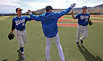Western Nevada College's Alex Fife greets outfielders Joey Crunkilton and Corey Pool during their college baseball game against the College of Southern Idaho at John L. Harvey Field, in Carson City, Nev., on Friday, March 28, 2014. <br /> Photo by Cathleen Allison/Nevada Photo Source