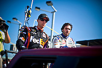 Championship rivals Denny Hamlin (#11) (L) and Jimmie Johnson (#48) rode around the track together during pre-race ceremonies.