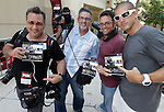 John Parra, Alberto Tamargo, Martin Fried and Alexander Tamargo with their new Think Tank Photo catalogs after  covering auditions for Simon Cowell's new Fox TV show The X Factor on June 14, 2011 at the BankUnited Center in Coral Gables.