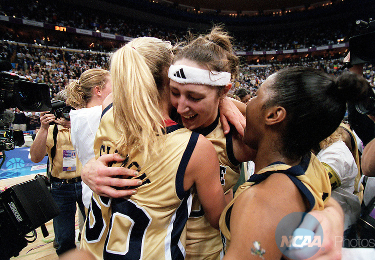 01 APR 2001:  MVP Ruth Riley (00) hugs fellow senior teammates Kelley Siemon (50) and Niele Ivey(33) of Notre Dame after defeating Purdue during the Division 1 Women's Basketball Championships held at the Savvis Center in St. Louis, MO.  Notre Dame defeated Purdue 68-66 for the national championship title.  Jamie Schwaberow/NCAA Photos