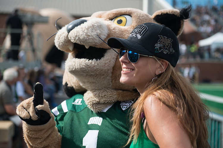Christine Oblak, an Ohio University College of Business alumna, hugs Rufus during the Bobcat's homecoming matchup against Bowling Green at Peden Stadium in Athens, Ohio on Saturday, October 8, 2016.