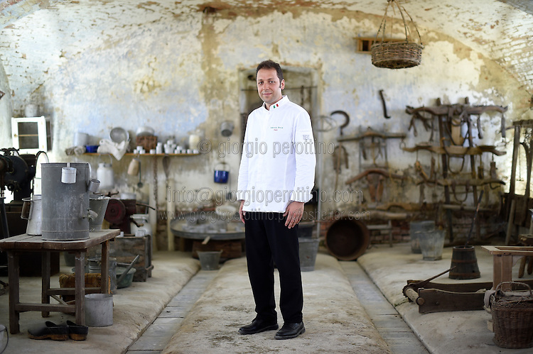 Fabrizio Boca, Chef to the President of the Republic of Italy Sergio Mattarella, poses for a portrait in the Cascina Colombara during the annual meeting of the Club des Chefs des Chefs in Livorno Ferraris, Vercelli, Italy, July 18, 2015.<br /> The Club des Chefs des Chefs, which is seen as the world's most exclusive gastronomic society, has extremely strict membership criteria: to be accepted into this highly elite club, you need to be the current personal chef of a head of state. If he or she does not have a personal chef, members can be the executive chef of the venue that hosts official State receptions. One of the society's primary purposes is to promote major culinary traditions and to protect the origins of each national cuisine. The Club des Chefs des Chefs also aims to develop friendship and cooperation between its members, who have similar responsibilities in their respective countries. <br /> The annual meeting of the Club has been hosted this year in the production site of the Italian rice company called Riso Acquerello. <br /> © Giorgio Perottino