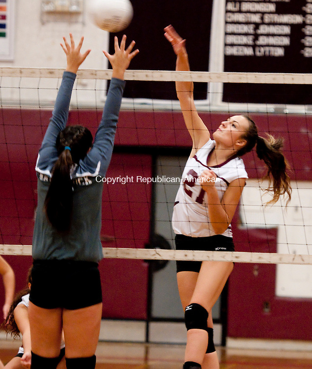 TORRINGTON, CT-100814JS14-  Torrington's Miah Giarnese spikes the ball past Naugatuck's Ally Mezzo (9) during their match Wednesday at Torrington High School. <br /> Jim Shannon Republican-American