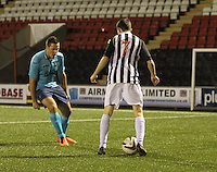 Lewis Morgan takes on Stephen Husband in the St Mirren v Dunfermline Athletic Scottish Professional Football League Under 20 match played at the Excelsior Stadium, Airdrie on 11.12.13.