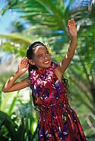 Beautiful Young Hawaiian girl dancing an aunana (modern) hula with an orchid lei and plumeria flower in her ear
