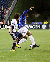 New England Revolution defender Kevin Alston (30) pursues Cruzeiro forward Eliandro (19).  Brazil's Cruzeiro beat the New England Revolution, 3-0 in a friendly match at Gillette Stadium on June 13, 2010