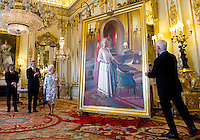 Prime Minister Stephen Harper, second from left, stands with Queen Elizabeth as she unveils a portrait of herself in the White Drawing Room at Buckingham Palace in London on Wednesday, June 6, 2012. The portrait was painted by Canadian artist Phil Richards, left. Governor General David Johnston looks on from right. THE CANADIAN PRESS/Sean Kilpatrick