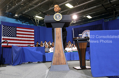 United States President Barack Obama pauses as he speaks during a town hall meeting at the Northern Virginia Community College April 19, 2011 in Annandale, Virginia. Obama discussed his vision for bringing down the deficit at the town hall meeting. .Credit: Alex Wong / Pool via CNP