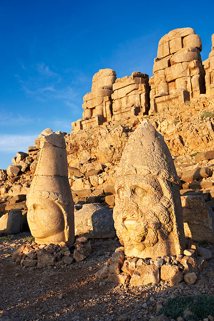 Image of the statues of around the tomb of Commagene King Antochus 1 on the top of Mount Nemrut, Turkey. Stock photos & Photo art prints. In 62 BC, King Antiochus I Theos of Commagene built on the mountain top a tomb-sanctuary flanked by huge statues (8–9 m/26–30 ft high) of himself, two lions, two eagles and various Greek, Armenian, and Iranian gods. The photos show the broken statues on the  2,134m (7,001ft)  mountain. 5