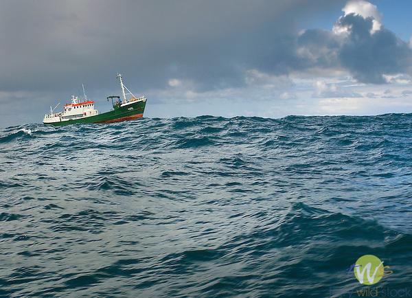 Boat in North Atlantic Ocean rough sea.