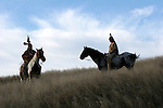 Two young Native American Indians bareback on horses
