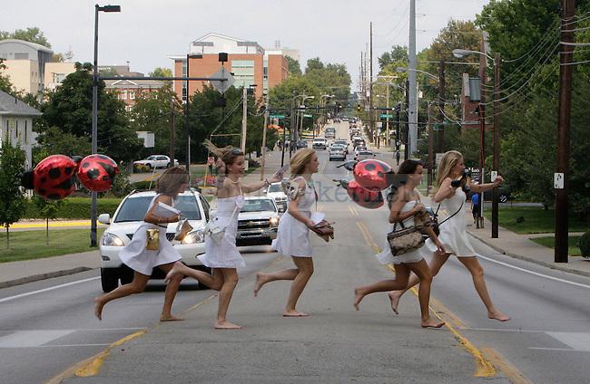 Members of the Kappa Delta sorority ran across Rose Street at sorority bid day in Lexington, Ky., on Thursday, August 22, 2013. Photo by Tessa Lighty | Staff