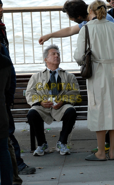 "DUSTIN HOFFMAN & EMMA THOMPSON .On the set of ""Last Chance Harvey"" refilming scenes near The Royal Festival Hall, Embankment, London, England..May 21st, 2008.film movie full length back behind rear sitting bench beige trench coat mac .CAP/IA.©Ian Allis/Capital Pictures."