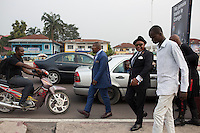 """KINSHASA, DEMOCRATIC REPUBLIC OF CONGO - FEBRUARY 10: Sapeurs from the group belonging to Papa Griffe walks on Avenue De La Democratie on February 10, 2016 in Kinshasa, DRC. The word Sapeur comes from SAPE, a French acronym for Société des Ambianceurs et Persons Élégants. or Society of Revellers and Elegant People. and it also means, .to dress with elegance and style"""". Most of the young Sapeurs are unemployed, poor and live in harsh conditions in Kinshasa, a city of about 10 million people. For many of them being a Sapeur means they can escape their daily struggles and dress like fashionable Europeans. Many hustle to build up their expensive collections. Most Sapeurs could never afford to visit Paris, and usually relatives send or bring clothes back to Kinshasa. (Photo by Per-Anders Pettersson)"""