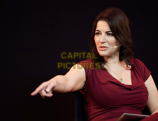 TV chef and writer Nigella Lawson speaks to the public about her cookbooks, TV series and award-winning apps at Apple Store, London, England..October 29th, 2012.half length maroon burgundy hand arm pointing .CAP/BF.©Bob Fidgeon/Capital Pictures.