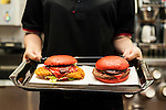 Burger King's two new red burgers, the AKA SAMURAI CHICKEN (left) and the AKA SAMURAI BEEF, went on sale on Friday July 3, 2015, in Tokyo, Japan. The two new burgers use red buns and red cheese, colored by tomato powder and spicy red sauce and will be sold at Japanese branches until August. The AKA SAMURAI CHICKEN costs 540 JPY (4.39 USD) and the AKA SAMURAI BEEF costs at 690 JPY (5.61 USD). As a part of the promotion Burger King plans to launch two new black burgers on August 21st. (Photo by Rodrigo Reyes Marin/AFLO)