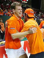 06-03-2005,Swiss,Freibourgh, Davis Cup , Swiss-Netherlands, Sjeng Schalken  celebrates his victoty with Raemon Sluiter