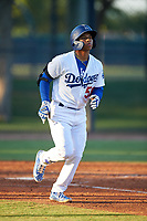 AZL Dodgers Lasorda Jorbit Vivas (56) jogs towards first base after being walked during an Arizona League game against the AZL Athletics Green at Camelback Ranch on June 19, 2019 in Glendale, Arizona. AZL Dodgers Lasorda defeated AZL Athletics Green 9-5. (Zachary Lucy/Four Seam Images)