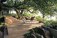 Cut flagstone patio landing in Santa Barbara garden with lounge chairs