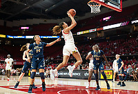 COLLEGE PARK, MD - NOVEMBER 20: Shakira Austin #1 of Maryland goes past Kayla Mokwuah #24 of George Washington for a shot during a game between George Washington University and University of Maryland at Xfinity Center on November 20, 2019 in College Park, Maryland.