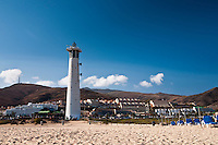 Beach front at the Morro jable resort (Jandia beach), Fuerteventura, Canary islands, Spain. This beach stretches from Morro Jable to Costa Calma, about 21 Km. The influence of tourism is hard to miss, and some of the resorts turn the beach fronts into concrete blocks.