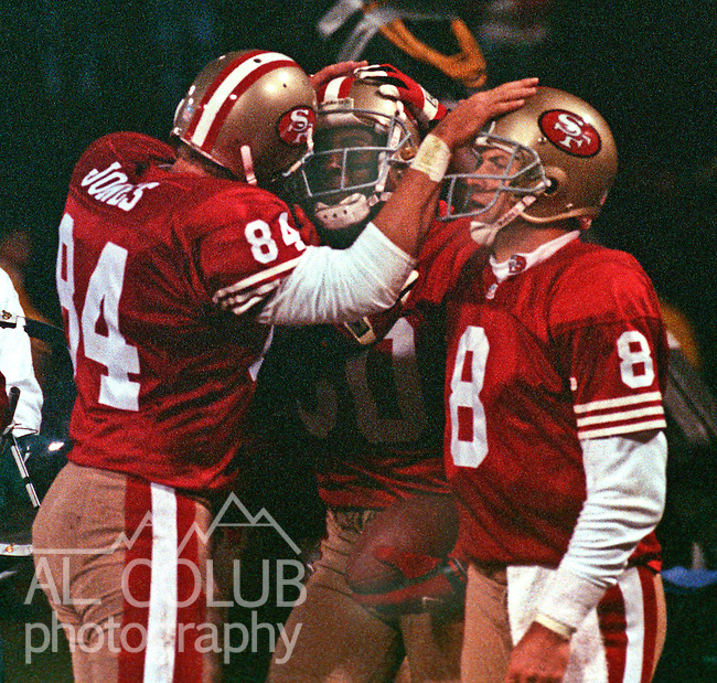 San Francisco 49ers vs. Philadelphia Eagles at Candlestick Park Monday, January 3, 1994.  Eagles Beat 49ers 37-34-OT.  San Francisco 49ers tight end Brent Jones (84) and quarterback Steve Young (8) congratulate wide receiver Jerry Rice (80) on touchdown.