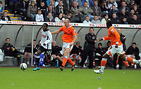 ATTENTION SPORTS PICTURE DESK<br /> Pictured: Nathan Dyer of Swansea (L) chased by Stephen Crainey of Blackpool<br /> Re: Coca Cola Championship, Swansea City Football Club v Blackpool at the Liberty Stadium, Swansea, south Wales. Saturday 24 October 2009