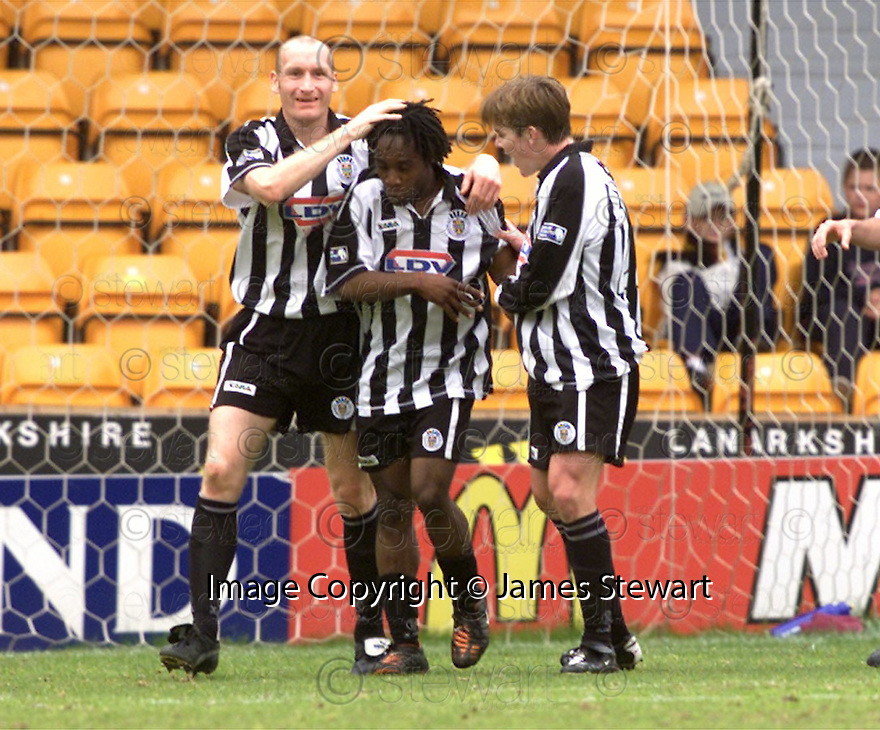 20th May 2001   Copyright Pic : James Stewart .Ref :                           .File Name : stewart04-motherwell v st mirren.JOSE QUITONGO IS CONGRATULATED AFTER SCORING ST MIRREN'S FIRST.........James Stewart Photo Agency, Stewart House, Stewart Road, Falkirk. FK2 7AS      Vat Reg No. 607 6932 25.Office : +44 (0) 1324 630007     Mobile : 07721 416997.Fax     :  +44 (0) 1324 630007.E-mail : jim@jspa.co.uk.If you require further information then contact Jim Stewart on any of the numbers above.........