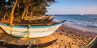 Panoramic photo of a traditional Sri Lanka fishing boat, Mirissa Beach, South Coast of Sri Lanka, Asia. This is a panoramic photo of a traditional Sri Lanka fishing boat on Mirissa Beach, Sri Lanka, Asia.