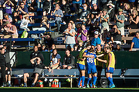 Seattle, Washington - Saturday, July 2nd, 2016: Seattle Reign FC forward Nahomi Kawasumi (36) celebrates her goal with her teammates during a regular season National Women's Soccer League (NWSL) match between the Seattle Reign FC and the Boston Breakers at Memorial Stadium. Seattle won 2-0.