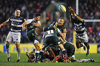 Ben Youngs of Leicester Tigers box-kicks the ball as Niko Matawalu of Bath Rugby looks to charge him down. Aviva Premiership match, between Leicester Tigers and Bath Rugby on November 29, 2015 at Welford Road in Leicester, England. Photo by: Patrick Khachfe / Onside Images