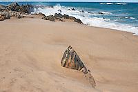 Rocks mark the end of a stetch of sand, Middleton, South Australia.