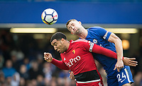 Troy Deeney of Watford & Gary Cahill of Chelsea during the Premier League match between Chelsea and Watford at Stamford Bridge, London, England on 21 October 2017. Photo by Andy Rowland.