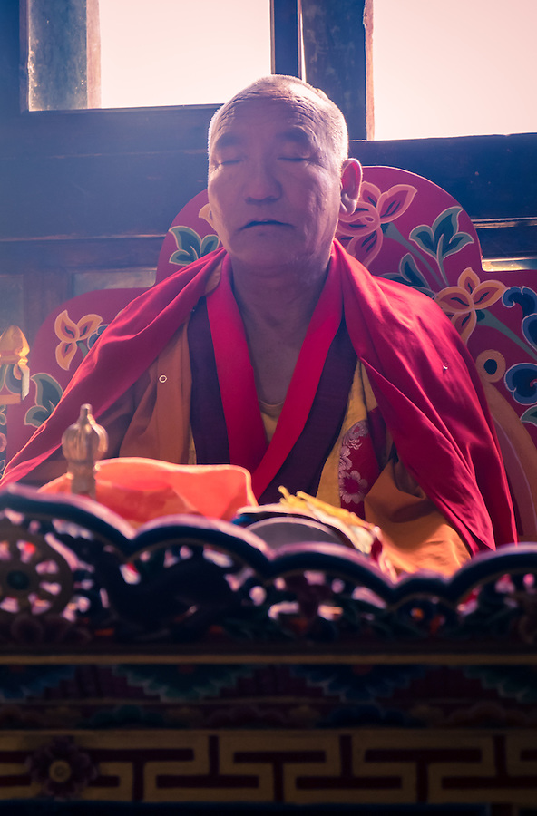PARO, BHUTAN - CIRCA OCTOBER 2014: Bhutanese monk chanting and meditating during a ritual in Paro, Bhutan