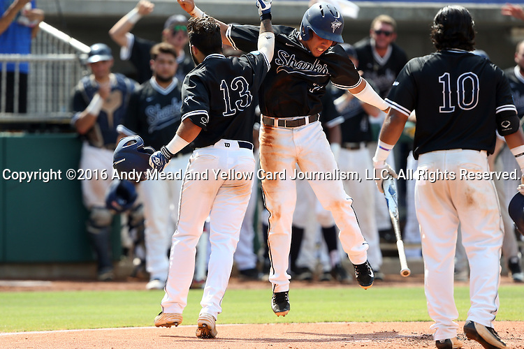 04 June 2016: Nova Southeastern's Kevin Suarez (13) celebrates his home run with Jancarlos Cintron-Torres (7). The Nova Southeastern University Sharks played the Millersville University Marauders in Game 14 of the 2016 NCAA Division II College World Series  at Coleman Field at the USA Baseball National Training Complex in Cary, North Carolina. Nova Southeastern won the game 8-6 and clinched the NCAA Division II Baseball Championship.