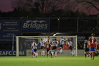 Josh Gowling of Grimsby Town deflects a shot from Charlie Walker of Aldershot Town for the opening goal during the Vanarama National League match between Aldershot Town and Grimsby Town at the EBB Stadium, Aldershot, England on 5 April 2016. Photo by Paul Paxford / PRiME Media Images.