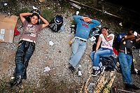 """Central American immigrants sleep under the stopped cargo train called 'La Bestia' (The Beast) on a train station in a border town of Arriaga, Mexico, 25 May 2010. Between 2010 and 2015, the US and Mexico have apprehended almost 1 million illegal immigrants from El Salvador, Honduras, and Guatemala. While the economic reasons remain the most frequent motivation for people from Central America to illegally immigrate to the US, thousands of Salvadorans, Guatemalans, and Hondurans, many of them minors, seek asylum in the US due to the thriving crime and gang-related violence in their region (known as the Northern Triangle). Taking an exhausting and risky journey, riding thousands of miles atop the cargo trains, facing a physical danger and extortion from the organized crime groups that control migrant routes, the """"undocumented"""" still flee to the US, looking for their American dream."""