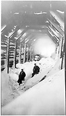 Two men in snowshed with stalled engine.<br /> D&amp;RGW