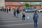Covid-19 pandemic.  Queue outside a branch of Sainsburys, Finchley Road, London, during the Covid-19 lockdown.