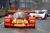 MIAMI, FL - FEBRUARY 23: The Joest Racing Porsche 962C of Gianpiero Moretti and Massimo Sigala leads a group of cars in the rain during the Toyota Grand Prix of Miami IMSA GTP/Lights race on the temporary street circuit in Bicentennial Park in Miami, Florida, on February 23, 1992.