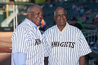 Former Charlotte Hornets Tony Oliva (left) and Minnie Mendoza have their picture taken prior to the International League game between the Durham Bulls and the Charlotte Knights at BB&T BallPark on May 16, 2017 in Charlotte, North Carolina.  The Knights defeated the Bulls 5-3. (Brian Westerholt/Four Seam Images)