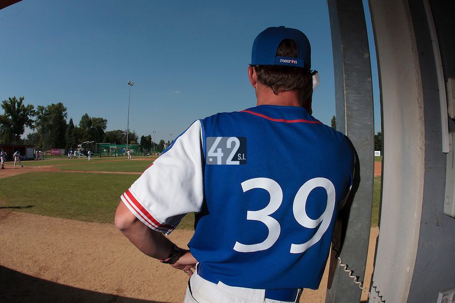 20 August 2010: Team Manager Boris Rothermundt is seen on the bullpen phone during France 6-5 win over Italy, at the 2010 European Championship, under 21, in Brno, Czech Republic.