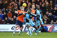 Craig Mackail-Smith of Luton Town and Aaron Pierre of Wycombe Wanderers in an aerial battle during the Sky Bet League 2 match between Luton Town and Wycombe Wanderers at Kenilworth Road, Luton, England on 26 December 2015. Photo by David Horn.