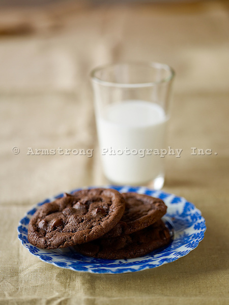 Chocolate-chocolate chip cookies with a glass of milk.
